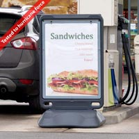 Advocate™ Floor Standing Poster Display Sign sited by the petrol pumps