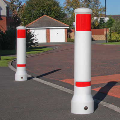 White Advanced Neopolitan 150 bollards with red retroreflective patches