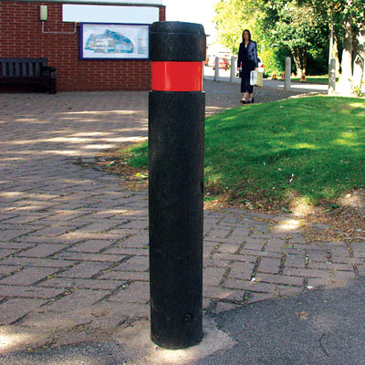 Black Flat Top Enviropol bollard with red retroreflective banding