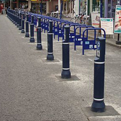Dark Blue Neopolitan Signhead bollard with white retroreflective banding and Cycle Parking Signs