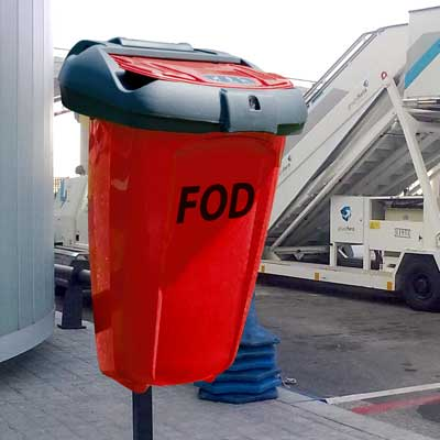 FOD 50 Bin in orange and post mounted at an airport